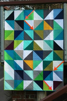 I love these half square triangle quilts.  It looks like this quilter quilted diagonally across each row.