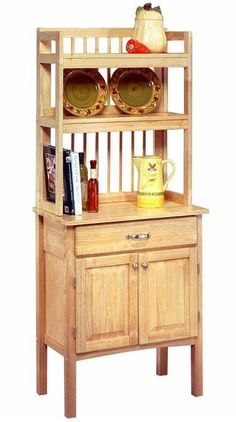 This simple and practical all wood baker's rack features ample storage behind closed doors, a generous work surface, and two shelves for storage. The natural wood tone will work in many kitchens, and the hardwood construction makes it both durable and easy to care ...