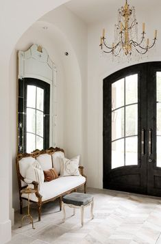foyer, entry way, french doors, European, settee, antique mirror, chandelier, gold accents, elegant, traditional, European, neutrals