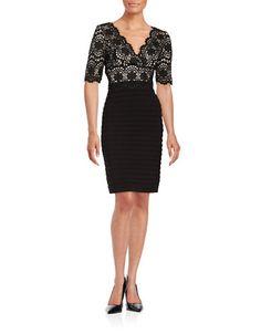 """<ul> <li>Romantic lace tops a fitted, pintucked design</li> <li>Surplice neckline</li> <li>Short sleeves</li> <li>Concealed back zipper closure</li> <li>Princess seams</li> <li>Pintucked skirt</li> <li>Lined</li> <li>About 40"""" from shoulder to hem</li> <li>Polyester/elastane</li> <li>Dry clean</li> <li>Imported</li> <li>This item will arrive with a tag attached and instructions for removal. Once tag is removed, this item cannot be returned.</li> </ul>"""