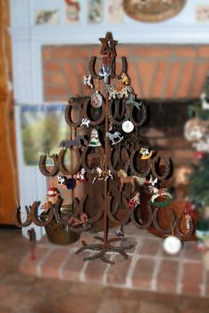 "Horse shoe Christmas tree- ""My Guy"" should make me one of these !)"