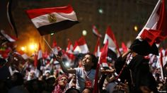 Protesters, who are against Egyptian President Mohamed Morsi, react in Tahrir Square in Cairo