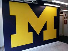 Man cave M wall, 10 feet X 7 feet 2 inches. Go Blue! Michigan Man Cave Ideas, Michigan Gear, Michigan Go Blue, State Of Michigan, University Of Michigan, Man Cave Essentials, Michigan Wolverines Football, Sports Graphics, Garage