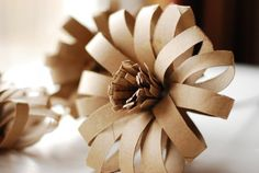 Paper Flower made from a recycled wrapping paper tube and a recycled toilet paper roll. Toilet Roll Craft, Toilet Paper Roll Art, Toilet Paper Roll Crafts, Toilet Tube, Cardboard Paper, Cardboard Crafts, Diy Paper, Cardboard Playhouse, Cardboard Furniture