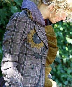 I remember my mother having a suit jacket like this but not quite as big a plaid. The addition of flower and ruffle make it wearable again.
