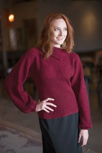 Inara Sweater - from Love of Knitting's Holiday Knits 2014 Issue  Vertical ribbing creates a flattering silhouette and can be blocked to your desired fit, enabling you to wear it as loose or form-fitting as you like. An interesting, asymmetrical collar gives this sophisticated sweater a unique appeal, while the beautiful texture on the yoke exudes class and style.