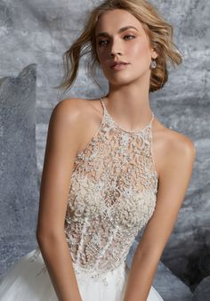 Toned arms will take center stage in this embellished halter dress by  Morilee by Madeline Gardner d19cc93fb58c