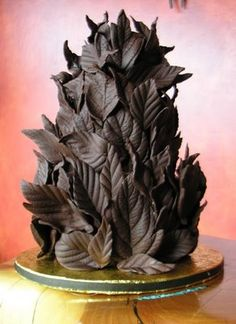 dark chocolate cake covered with  hand-made dark chocolate leaves