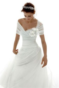 I'm not in the market for a wedding dress...but this one just calls out to me :)  Love it!!