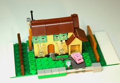extraordinary part usage !!!!!!! chair for roof, book for garage roof, and more... The Simpsons House | Flickr - Photo Sharing!