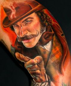 Reminds me of Daniel D. Lewis in Gangs of New York. If it's him, the tattoo artist is brilliant