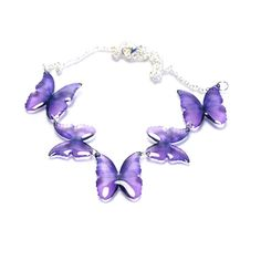 Magic Accessories Purple Morpho Necklace ($93) ❤ liked on Polyvore featuring jewelry, necklaces, monarch butterfly necklace, special occasion jewelry, purple butterfly necklace, monarch butterfly jewelry and holiday jewelry