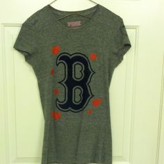 "VS PINK Red Sox short sleeve crew neck This VS PINK Red Sox short sleeve crew neck is in great used condition! There is small signs of wear (depicted in photo above, one heart is a little faded). This top is gray and a size XS. This top has red hearts on the front with the Red Sox 'B'. On the back it reads ""love love love red sox"". This top is super comfy and still has a lot of use left to it! Perfect to wear to a game or to cheer on the Sox from your couch! PINK Victoria's Secret Tops Tees…"