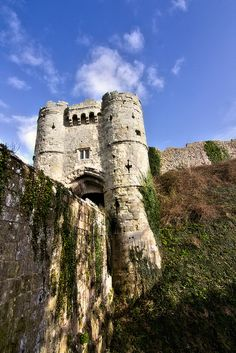 Carisbrooke Castle is a historic motte-and-bailey castle located in the village of Carisbrooke, near Newport, Isle of Wight, England