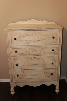 Radiantly Redeemed- Tall dresser painted in ASCP Old white over a previous blue paint.  Distressed to bring out a little of the blue, then used AS dark wax.  New hardware as well.  Solid wood.  Phenomenal piece!