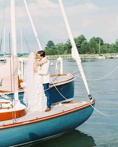 "A Blue-and-White Wedding on the Eastern Shore | Martha Stewart Weddings - This couple threw a big garden party by the water on July 11, 2015. ""My parents live on the shore, and we wanted a formal wedding that still felt almost like it was being held in their backyard,"" says Stephanie. They accomplished that through homey details—from cheerful illustrations on their save-the-date and signage to Teddy, the couple's pup, who romped his way through the ceremony."