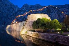 Kotor fortifications and St John's Hill stunningly illuminated at night. Image by Martin Child / Getty Images