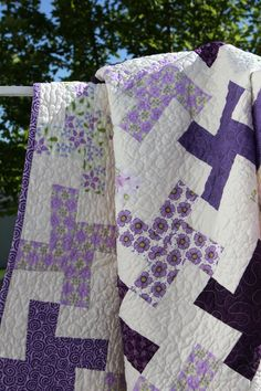 sweet quilt. Love the purples. I'll be doing one like this. So I'll be on a purple fabric quest. I'm up for it tho. :)