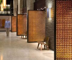 BRILLIANT beer bottle pivot doors at 'blatz brewery' in milwaukee, wisconsin by johnsen schmaling architects
