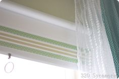 Still have those ugly roller blinds hanging in some of your windows? Dress them up a little with some craft tape........D.