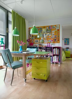 Gitte's colourful Danish apartment | Get inspired! Turn a room into a multipurpose space by adding castors to furniture so it's easy to move things around!