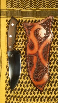 Handmade Campknife with micarta handles hand tooled leather sheath by GK Knives