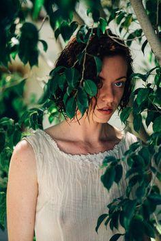 leaf-clad portrait by SAINT LUCY Represents photographer Cody Bratt
