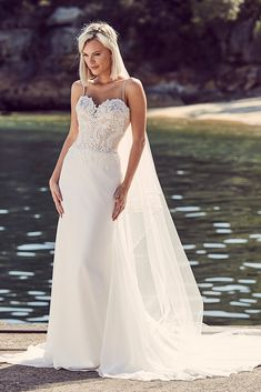 Lace bridal gown with softly fitted organza skirt by   Peter Trends Bridal. In stores now in the USA and Australia.