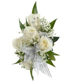 DECORATED ROSE CORSAGE, WHITE - A corsage with five white sweetheart roses and babies breath decorated with three iridescent rhinestone sprays and a white & silver bow. Designed as a wrist corsage, but can be converted to a pin on corsage with included pins. Item #4410.