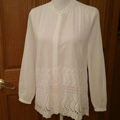 J. CREW White Button Down Embroidered Gorgeous white top by J. CREW in perfect condition. Hidden button enclosure under trim for a smooth finish. 100% cotton. Slight pleating at shoulders. Breastline across laying flat measures 18 inches. Length 25.5 inches. Arm inseam 17 with double button on sleeve. Shoulder to shoulder hem 14.5 embroidery stretches 11 inches from the bottom of the top. Perfect condition- like new. J. Crew Tops Button Down Shirts