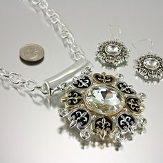 NEW! FLEUR DE LIS TWO TONE NECKLACE AND EARRING SET . INCLUDES   CHAIN.