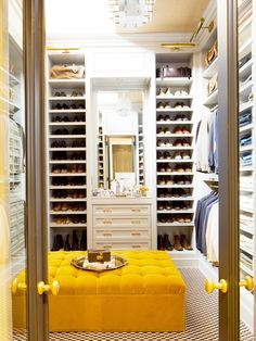 Nate Berkus' home closet features bright marigold velvet and accompanying gold hardware throughout. The sunny space gets plenty of natural light via a skylight, which we can only imagine to be wildly flattering.