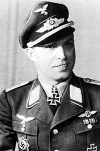 """Hauptmann Emil """"Bulli"""" Lang served with JG-54. He was decorated for his outstanding service in the Luftwaffe with the Knights Cross, then Oakleaves. He is credited with 173 victories, 144 in Russia/ 29 in West vs USAAF/RAF. He still holds alltime record of 18 kills in one day! He showed that being 34 was not a hindrance to being a topgun. Sadly, he had problems with he ME-109G fighter, and as a result was shot down Sept. 3rd/1944 by Spitfire."""