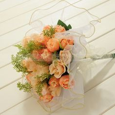 Trimmed Organza Wrapped Rose Wedding Bouquet in Light Orange