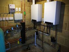 This is a recent Boiler room that we installed. The job involved the removal of an old oil boiler and hot water cylinders We then installed two new 24kw intergas boilers, linked together in a purpose built boiler room. New pipe work was re-routed to the main house which was split into zones, helping to reduce running costs. We also used a professional power flushing company to clean the existing heating system.