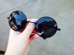 """John Lennon sunglasses in round black hand view  """"GOBSOC15"""" for 15% off your purchase at www.gardensofbutterflies.com"""