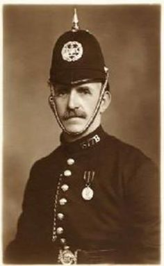 Mr Mackay, a constable in the Leith police force (near Edinburgh) in the 1930s. Note that although this was the 1930s the tunic has no breast pockets so the whistle chain is run down the front with the whistle tucked in to the jacket just above the belt.