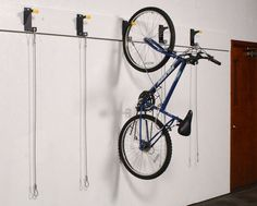 Multiple Bike Storage | WireCrafters - Bicycle Wall Riders can be mounted around a room continuously to store multiple bikes.