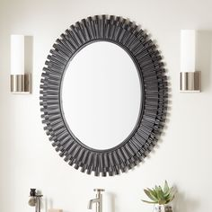 A perfect blend of artsy and glam, the Rubidoux Decorative Vanity Mirror will transform the look of your space. Its round frame completely handcrafted, pieces of iron in varying lengths are layered to create a striking design. Distressed markings and arti
