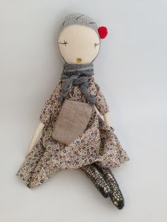 Jess Brown rag doll dressed in linen solids, seasonal vintage or liberty prints plus one accessory.Each doll is hand dyed in persian black teas to create variations in skin tones. They are all made of cotton muslin and linen, and primarily recycled and antique fabrics and findings. Each doll is stuffed with a sustainable corn fiber stuffing. Dolls are approximately 22 inches tall. Each doll is made with button shoulders and may not be appropriate for children under three yea...