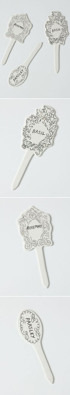 "Ceramic Plant Markers by Molly Hatch :: $6.00, Now $2.95 | anthropologie.com :: [6""L x 2.5""W] Stoneware. Dishwasher safe. :: I could have probably made these w/ some modeling clay, but at 2.50 a piece after discount, they were too cute to pass up. 