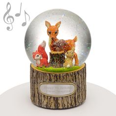 "Musical Water Globe - Forest Friends - This cute water globe features a tree trunk looking base with adorable woodland animal friends to make it the perfect gift for family, friends, teachers, or children. When wound the song that plays is ""Colour of the Wind."" Add your own engraved message to celebrate the occasion."