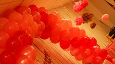 Large balloon arch over cake table for 1st birthday party