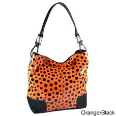 This glossy fashion hobo features a fun all over polka dot design with a faux leather trim. The interior is spacious enough to accommodate whatever belongings you need to get through your day. A single detachable shoulder strap provides comfort.