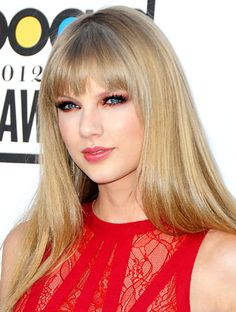 #TaylorSwift played off the bright strawberry color of her #ElieSaab dress when she showed up to the Billboard Music Awards with cranberry eye shadow. http://news.instyle.com/2012/05/24/billboard-awards-taylor-swift-red-eye-shadow/