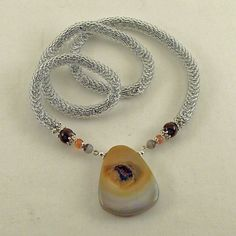 Handmade crochet crocheted bead rope necklace with a large focal Agate Druzy Drusy pendant.This necklace is crocheted by me with a dark grey polyamid thread for durability and to lend just a hint of color to complement the pendant. Thousands of cl...
