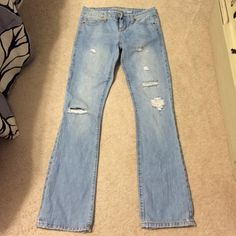 American Eagle jeans  Cute distressed jeans in great condition... Just too big for me..size 2 regular, true boot, 32 inch inseam American Eagle Outfitters Jeans