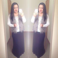 White tee faux fur vest black maxi skirt good tassel necklace modest winter fashion Instagram user @melbella14