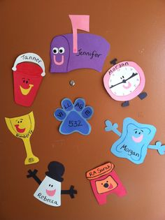 "Some door decs I did for my residents this year. I used construction paper, glue, and a little but of crayon details to make Blue's Clues characters, and don't forget the ""clue"" in the middle! // cute, simple."