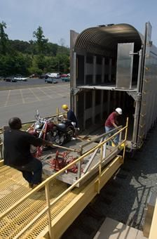 Amtrak, Auto Train  Cargo is loaded onto the Amtrak Auto Train at its Orlando stop.